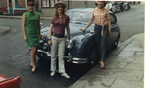 Marion, Ann and Mandy posing by Joe Baker's Jag. Outside at St. Nick's.